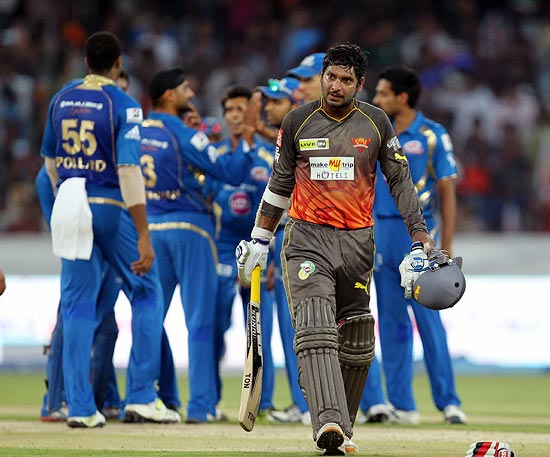 Kumar Sangakkara walks back after his dismissal