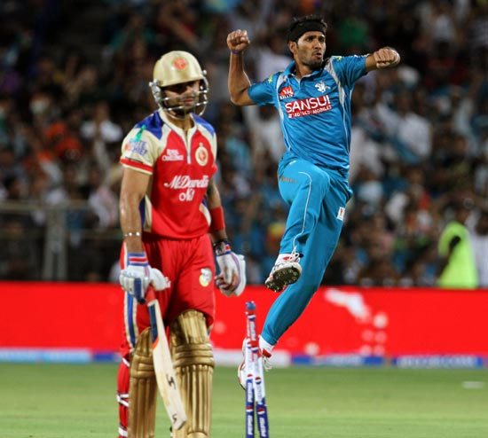 Ashok Dinda celebrates after taking the wicket of Virat Kohli