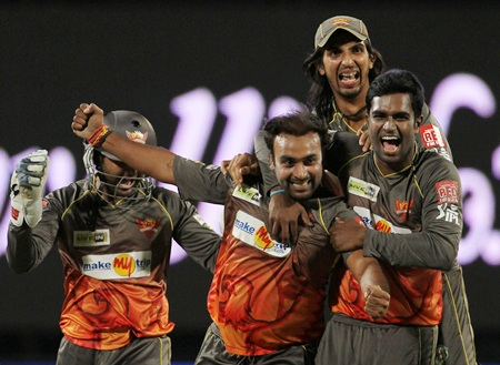 Amit Mishra is congratulated by Ishant and teammates