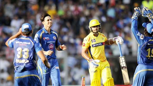 Mitchell Johnson celebrates the wicket of Murali Vijay