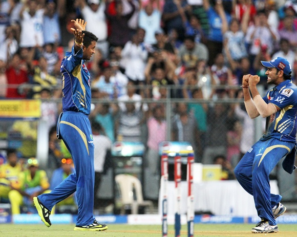 Pragyan Ojha celebrates with Rohit Sharma after taking the wicket of Michael Hussey