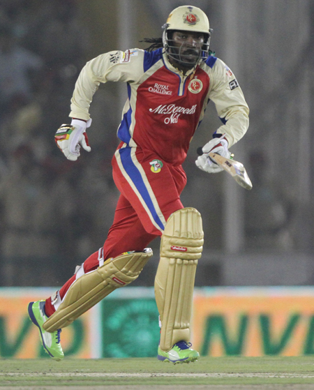Chris Gayle of the Royal Challengers Bangalore hits over the top for six
