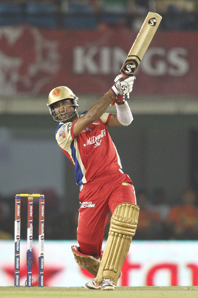 Cheteshwar Pujara of the Royal Challengers Bangalore hits over the top for a boundary