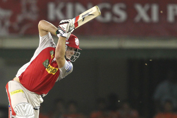 David Miller of Kings XI Punjab drives a delivery towards the boundary