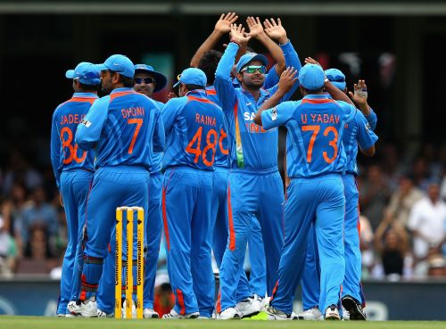 The Indian team celebrate a wicket