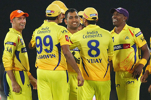 CSK captain MS Dhoni celebrates with teammates