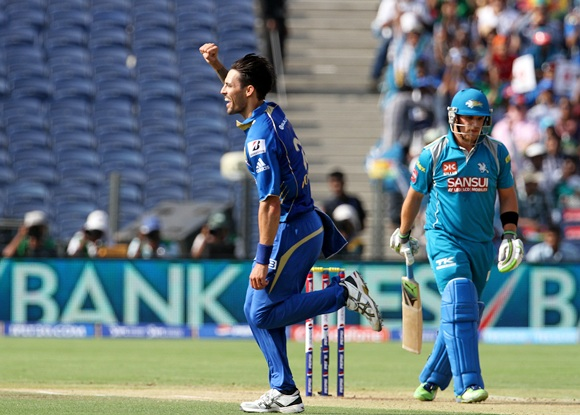 Mitchell Johnson celebrates after getting the wicket of Pune Warriors captain Aaron Finch
