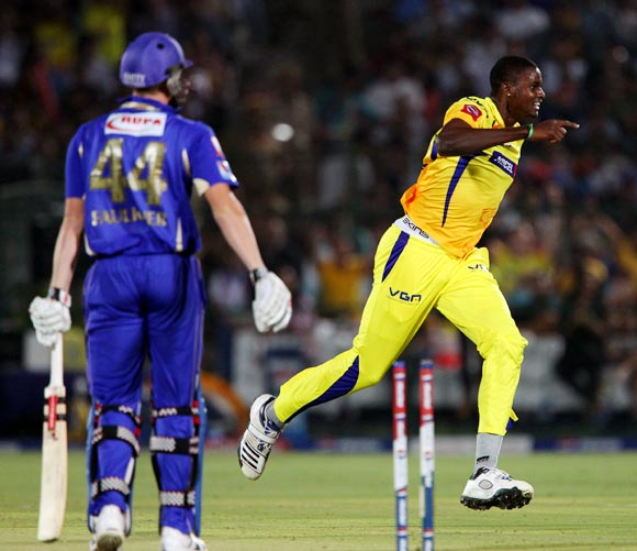 Jason Holder celebrates after getting the wicket of James Faulkner