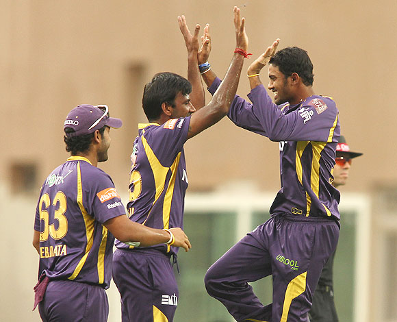 Lakshmipathy Balaji is congratulated by Sachithra Senanayake of Kolkata Knight Riders