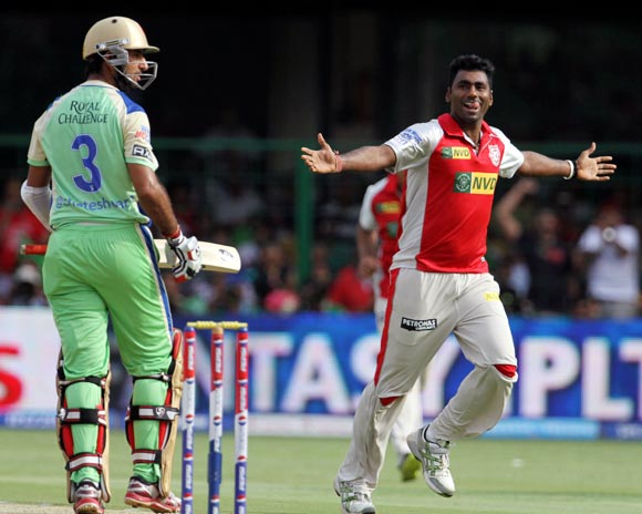 Parvinder Awana celebrates the wicket of Cheteshwar Pujara