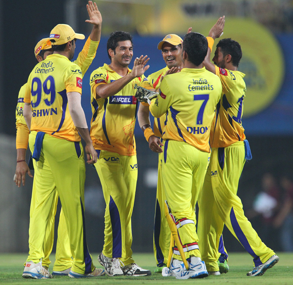 Chennai players celebrate the fall of a Delhi wicket