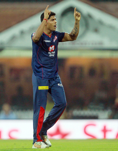 Umesh Yadav celebrates the wicket of Michael Hussey