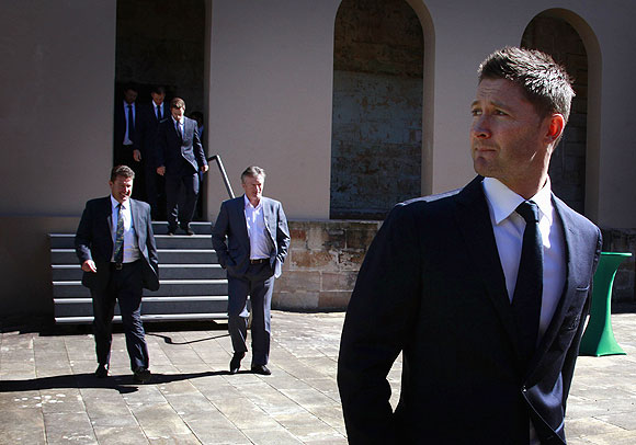 Current Australian cricket team captain Michael Clarke (rights) walks in front of former Australian team captains Mark Taylor (left) and Steve Waugh (2nd from right) before the start of a media conference in Sydney
