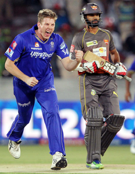 Shane Watson and team-mates congratulate Faulkner (right) on the dismissal of Shikhar Dhawan