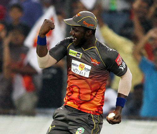 Darren Sammy celebrates taking the catch of Shane Watson