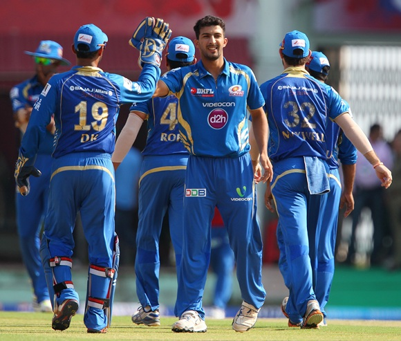 Rishi Dhawan celebrates