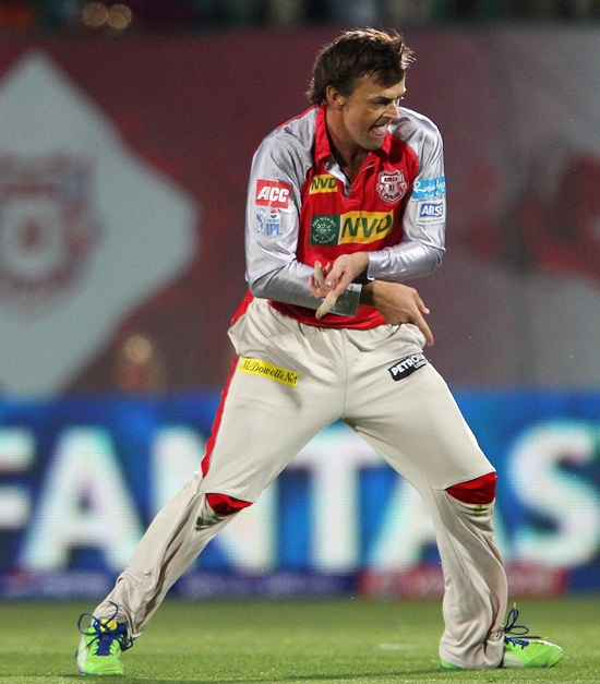 Adam Gilchrist celebrates the wicket of Harbhajan Singh