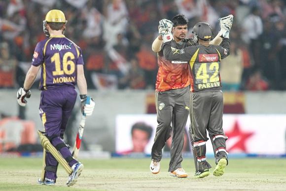 Karan Sharma celebrates with Parthiv Patel