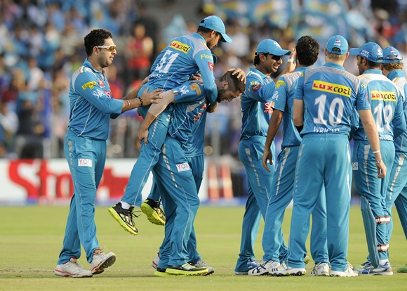 Pune Warriors players celebrate