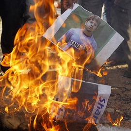 People burn Sreesath's picture in protest