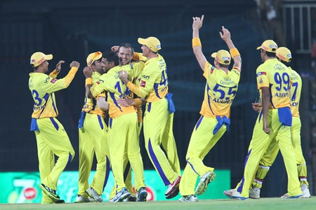 Chennai Super Kings player celebrate the fall of a wicket