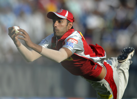 Gurkeerat Mann Singh of Kings XI Punjab dives to take a catch and get rid of Ross Taylor of Pune Warriors
