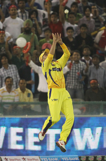 Michael Hussey leaps to take the catch and get rid of Manan Vohra of Kings XI