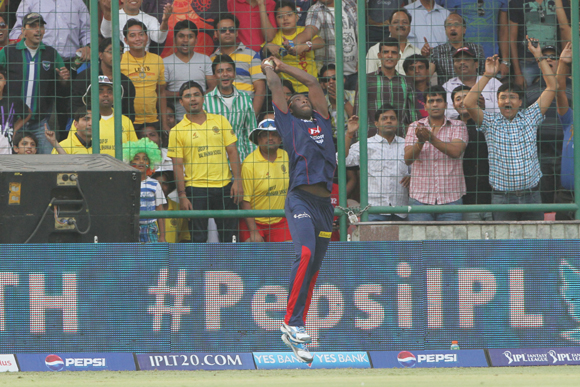 Delhi Daredevils' Andre Russell catches Mumbai Indians player Rohit Sharma