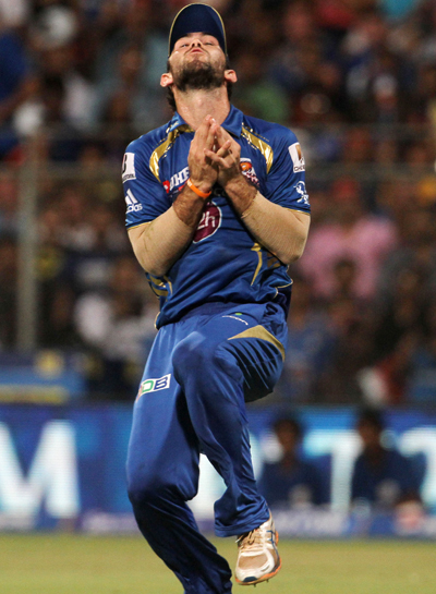 Mumbai Indians' Glenn Maxwell catches Rajasthan Royals player James Faulkner