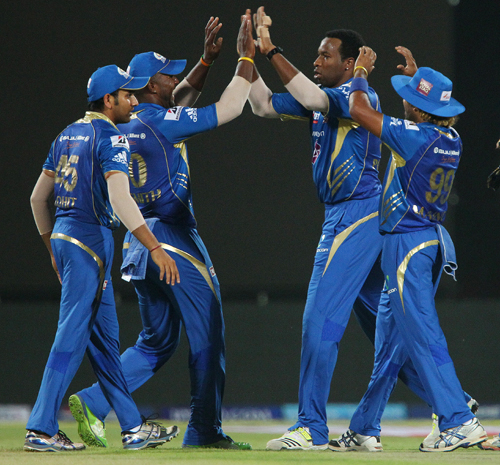 Kieron Pollard and Dwayne Smith celebrate the wicket of Murali Vijay