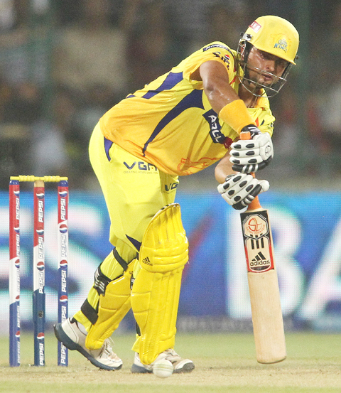 Suresh Raina of the Chennai Super Kings punches a delivery through the leg side