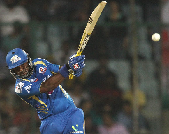 Dwayne Smith of Mumbai Indians hits over the top for six