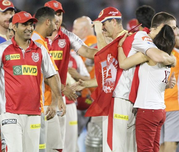 Preity Zinta hugs a player