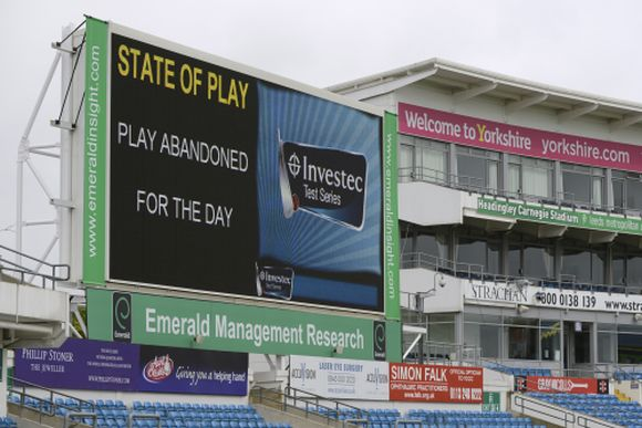 The scoreboard shows that play has been abandoned for the day at the second test cricket match between England and New Zealand at Headingley cricket ground