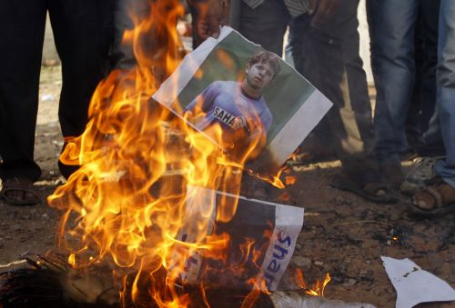Demonstrators in Ahmedabad burn a poster of Shanthakumaran Sreesanth after the spot-fixing scandal became public