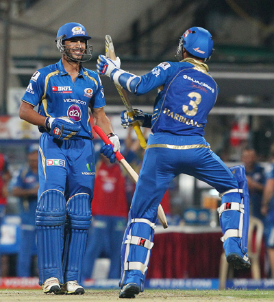 Harbhajan Singh and Rishi Dhawan celebrate Mumbai's win