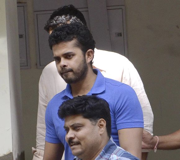 Shanthakumaran Sreesanth is taken to a court by police personnel in New Delhi