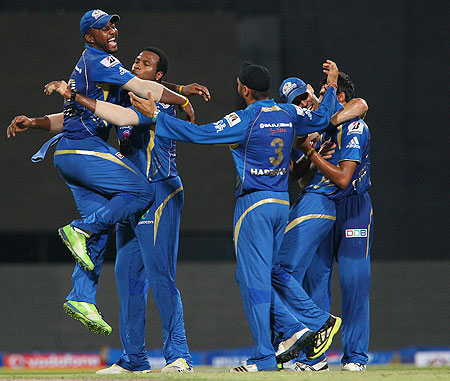 Mumbai Indians players celebrate a wicket