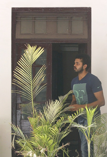 Sreesanth stands at the Delhi police crime branch office before being taken to the court