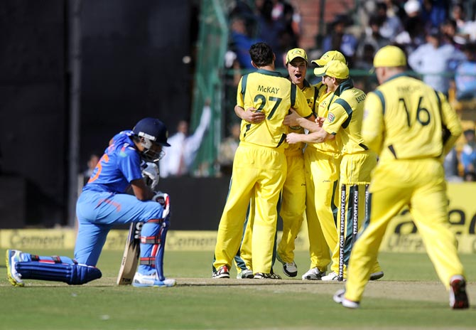 Australian players celebrate after the run out of Virat Kohli