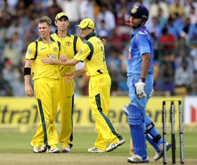 Xavier Doherty (left) celebrates with his team mates after getting the wicket of Suresh Raina