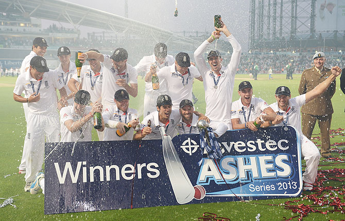 The England team celebrate their Ashes win in August this year