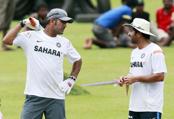 India's captain Mahendra Singh Dhoni (left) and Sachin Tendulkar