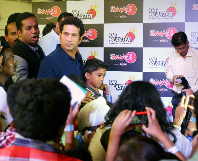 Sachin Tendulkar interacts with fans during a promotional event in Mumbai