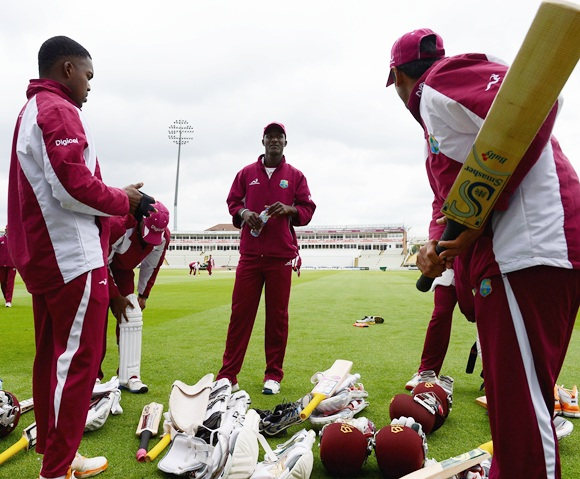 Captain Darren Sammy (centre) of the West Indies speaks to his players