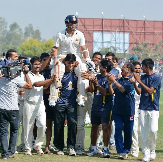 Sachin Tendulkar is chaired off the ground by his Mumbai teammates after victory over Haryana, in Lahli