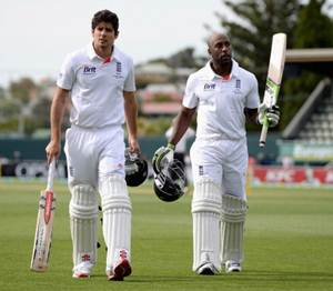 England captain Alastair Cook and Michael Carberry leave the field at the end of the day's play