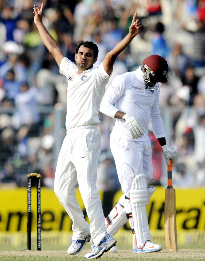 Mohammed Shami celebrates the dismissal of Sheldon Cottrell