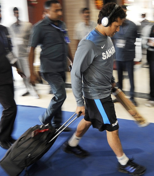 Sachin Tendulkar walks in to the stadium as Indian team arrives on Day 1 of the first Test at the Eden Gardens in Kolkata