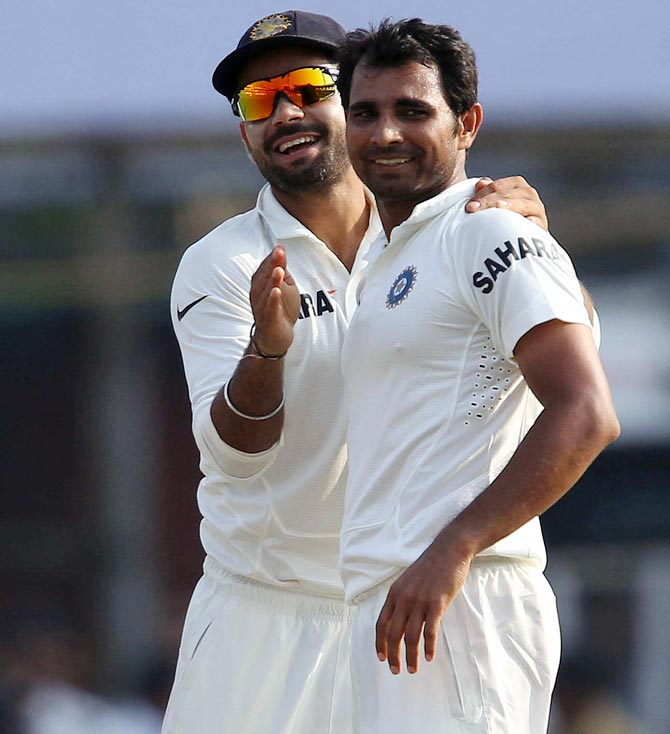 Mohammed Shami (right) celebrates with Virat Kohli after taking a wicket